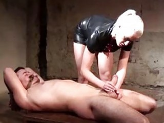 Tied up slave cock teased by leather wearing BDSM mistress