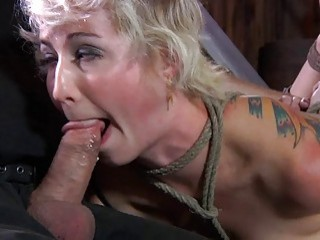 Athletic blonde hangs in the air while being in bondage
