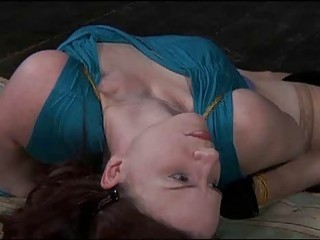 Elegant babe in stockings tries to free herself from bondage