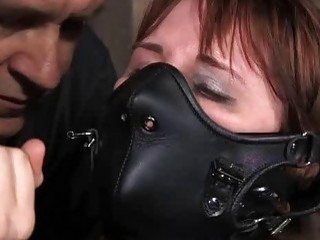 Redhead woman in the sex dungeon has bondage sex BDSM