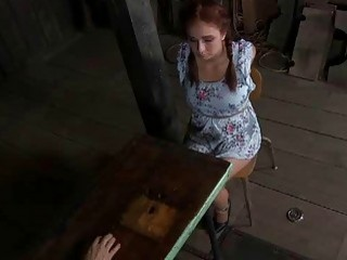 Redhead slave girl having bondage sex in the dungeon BDSM