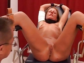 Blonde slave is bound waxed and toyed by her doctor