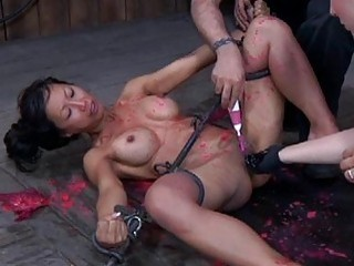 Asian slave punished with hot wax and hard pussy fisting