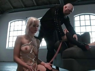 Sensual blonde gets in the bondage and loves the pain