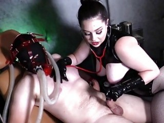 Mistress with big titties teases her slaves cock with probe