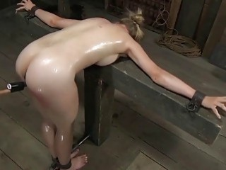 Cute chick is tied up and caned in a dungeon
