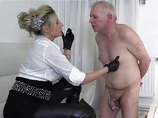 Old dude gets cock caged by a dominant young gal
