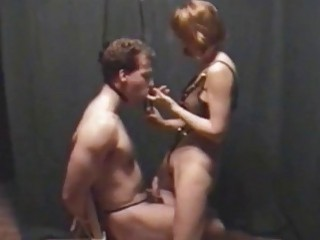 Muscular dude is tied up and teased by gentle domme