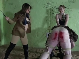 Cute babes whipping a dudes big fat ass real hard