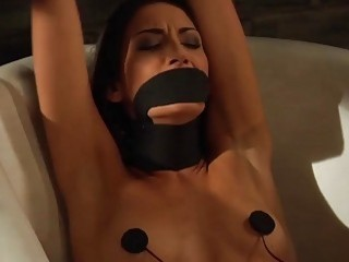 Lesbian domina ties her subject up and fucks her pussy