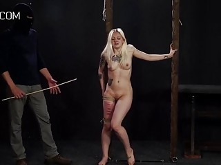 Blondie is tied up and she is getting caned hard