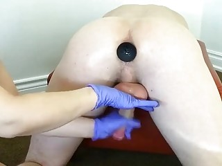 Dude gets a buttplug inside him and he gets milked
