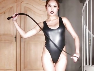 Asian mistress shows off her whip and her leather suit