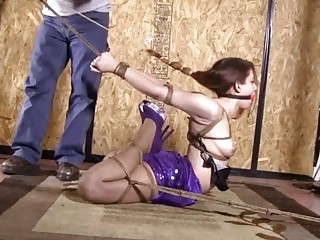Submissive girl in stockings and heels enjoys BDSM and bondage