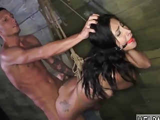 Gorgeous naked tattooed babe bangs hard in rough BDSM bondage
