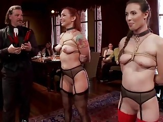 Two submissive naughties enjoy BDSM and bondage while people watch