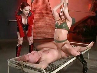 Bound slave gets molested by two femdom sluts BDSM porn
