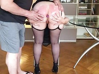 Curvy slave endures anal insertion and spanking by BDSM maste