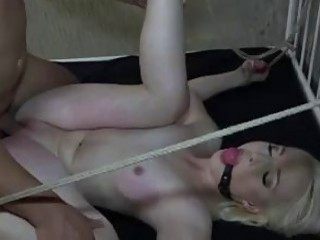 Tied up blonde babe gets fucked hard and rough BDSM