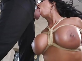 Brunette gets on her knees and sucks a big dick