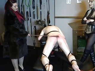 Slave with fat ass gets spanked by two horny gals
