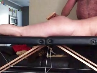 Hairy daddy spanks his submissive girl hard on the bench