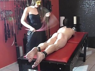 Slave with a fat ass gets caned by his mistress