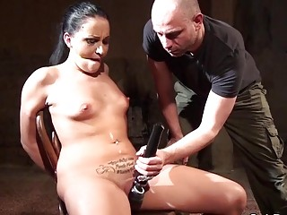 She is tied up to the chair and teased hard