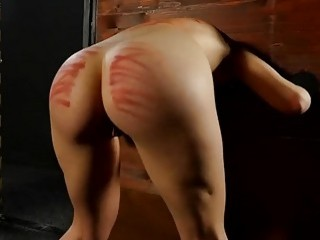 Chick is tied up and spanked hard by her master