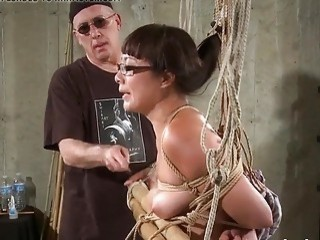 Cute Asian girl with glasses gets caned by her master
