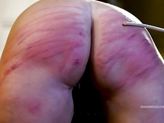 Babe with short hair gets her big ass caned hard