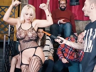 Blondie is tied up by master and whipped real hard