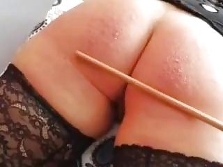 She gets her ass caned by her sadistic horny master