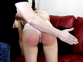 Big booty chick gets bent over and spanked real hard