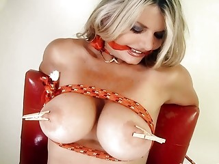 Busty blondie is tied up and vibrated with a wand