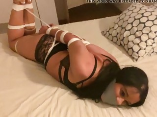Hogtied friend and gagged as well while struggling on bed