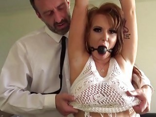 Ginger chick is tied up and her pussy is fucked