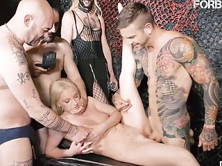 Blonde and slutty babe participates in a hardcore gang bang