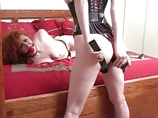 Submissive redhead obeys to BDSM and lezdom with her mistress