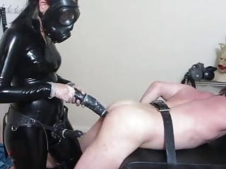 Girl in latex enjoys BDSM and femdom with her slave