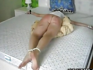 Submissive girl obeys BDSM and rough bondage spanking her ass