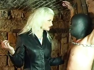 Tantalizing mistress enjoys BDSM and femdom with her chained slave