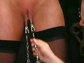 Submissive busty babe in stockings enjoys BDSM and body torture