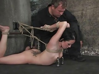 Gorgeous naked tattooed babe enjoys bondage and perverted BDSM playing