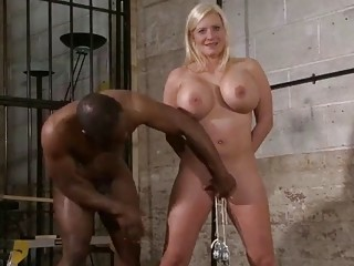 Naked girl with big tits enjoys BDSM with black stud