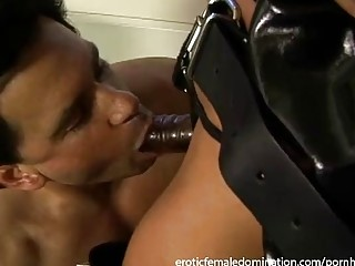 Dominant female uses sex toys to fuck her slave deep