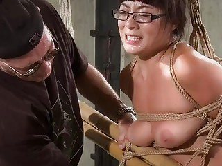 Submissive young babe with glasses is tied up and punished
