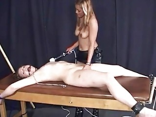 Brunette is tied up as her pussy is toyed deep