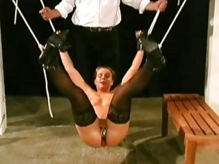 Master plays with his bound slave by clamping her pussy